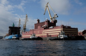 """The floating nuclear power plant """"Akademik Lomonosov"""" is seen being towed to Murmansk for nuclear fuel loading, in St. Petersburg"""