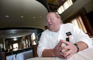 Celebrity chef Batali talks during an interview with Reuters at his latest restaurant, Del Posto, in New York