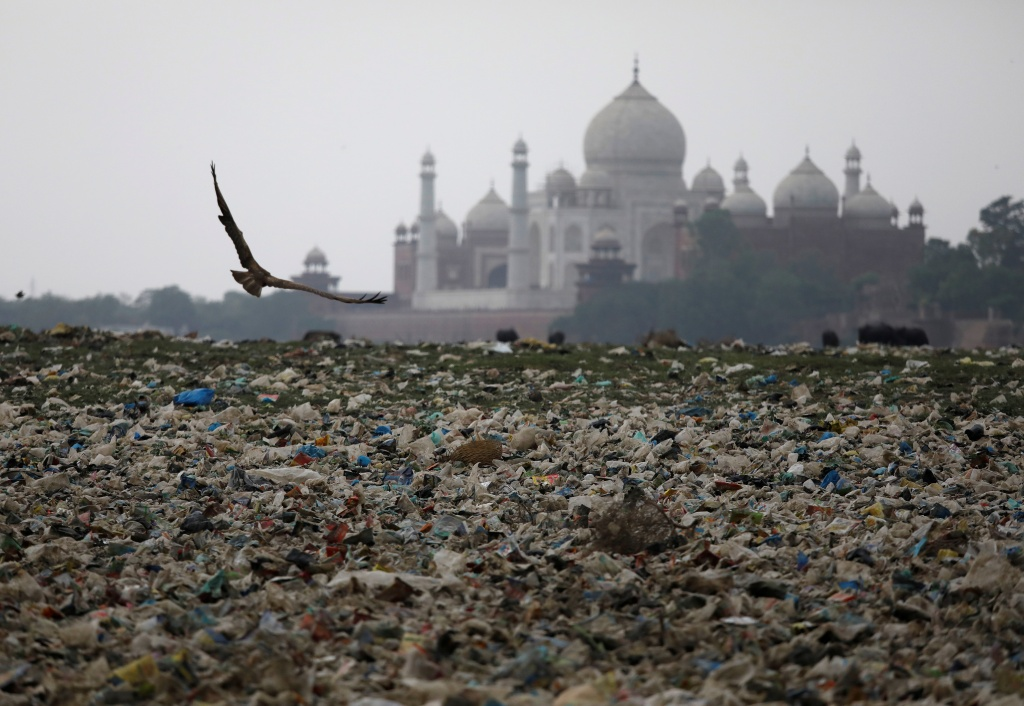Garbage is seen on the polluted banks of the river Yamuna near the historic Taj Mahal in Agra