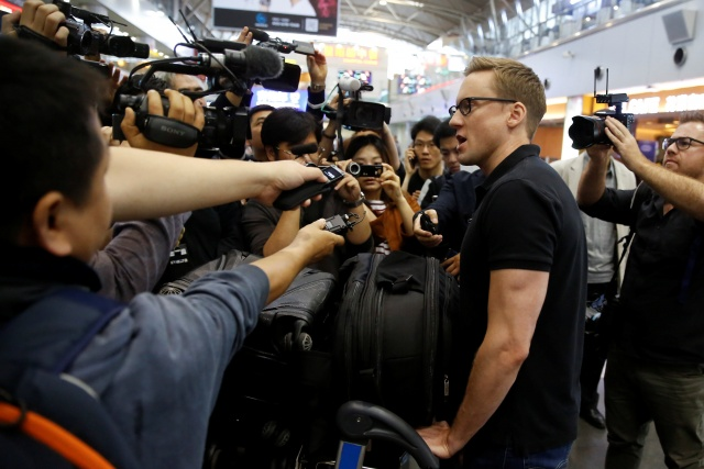 CNN's Will Ripley talks to the media after arriving at the aiport to board a plane to North Korea in Beijing