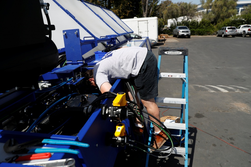 An engineer assembles a Blue River Technology See & Spray agricultural machine in Sunnyvale, California
