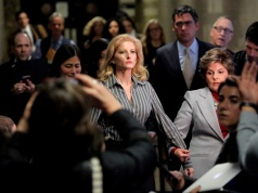 Zervos, a former contestant on The Apprentice, leaves New York State Supreme Court with attorney Allred in Manhattan