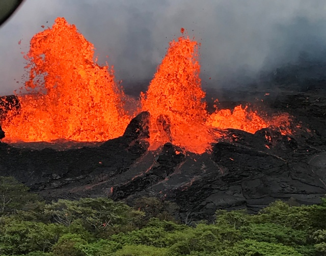 Lava fountain is observed from a helicopter flight over the Fissure 22 in Kilauea Volcano's Lower East Rift Zone during ongoing eruptions of the Kilauea Volcano in Hawaii