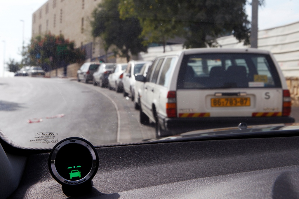A device, part of Mobileye driving assist system, is seen on the dashboard of a vehicle in Jerusalem