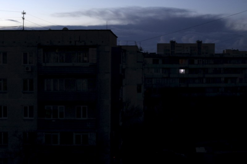 Single light illuminates a room during a blackout at a residential building in Yevpatoriya, Crimea