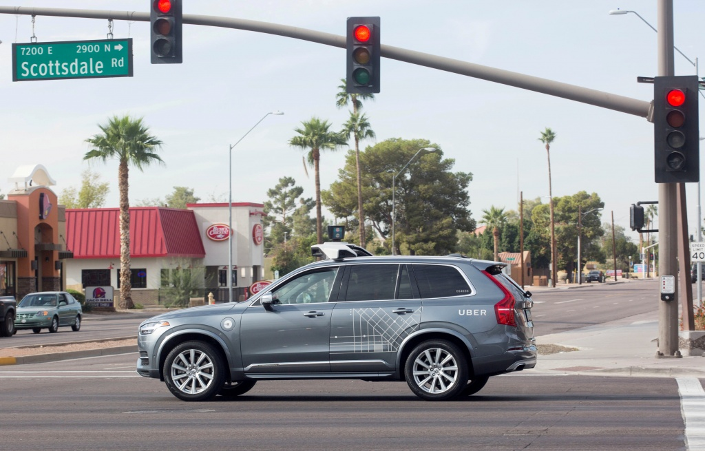 A self driving Volvo vehicle purchased by Uber moves through an intersection in Scottsdale
