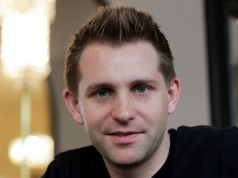 Austrian lawyer and privacy activist Schrems smiles during a Reuters interview in Vienna