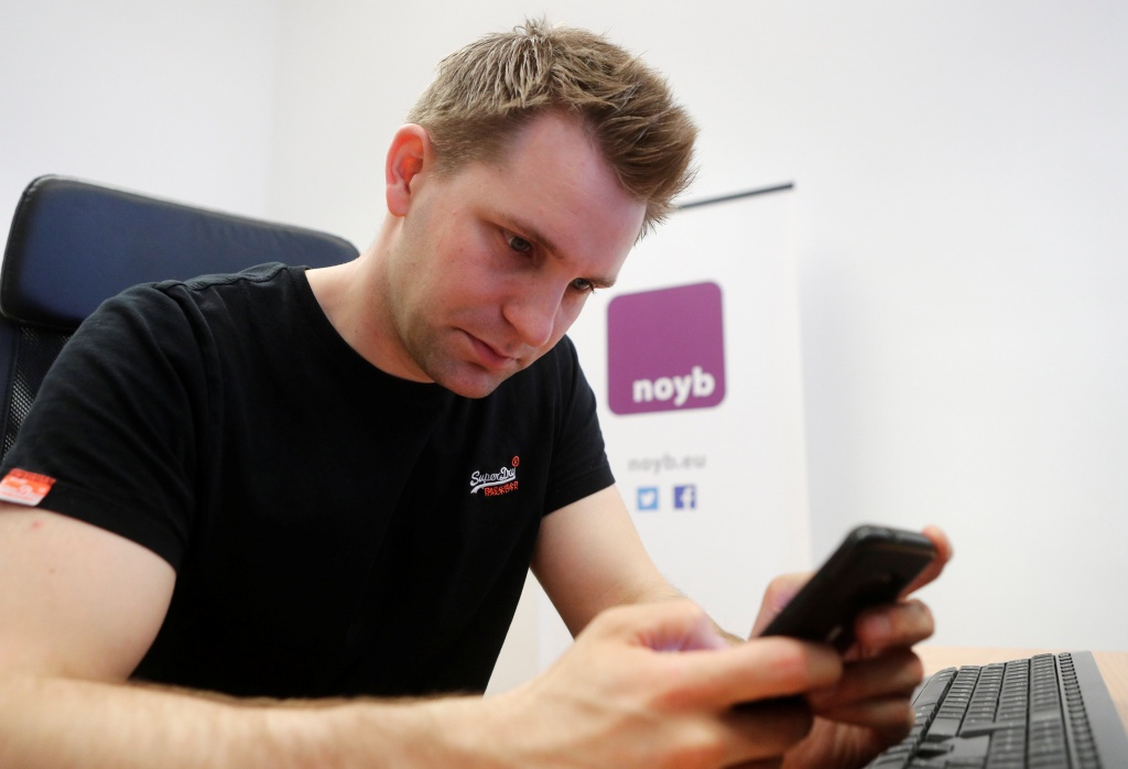 Austrian lawyer and privacy activist Schrems checks his mobile phone in his office in Vienna