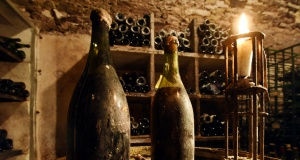 """Two vintage bottles of vin jaune """"yellow wine"""" from 1774 are presented in a cellar in Arbois"""
