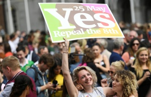 Women celebrate the result of yesterday's referendum on liberalizing abortion law, in Dublin