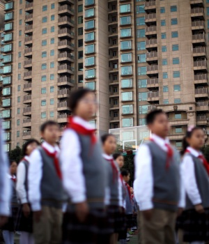 Members of Young Pioneers of China gather at the weekly flag-raising ceremony at a school in Shanghai