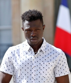 Mamoudou Gassama, 22, from Mali, leaves the Elysee Palace after his meeting with French President Emmanuel Macron, in Paris