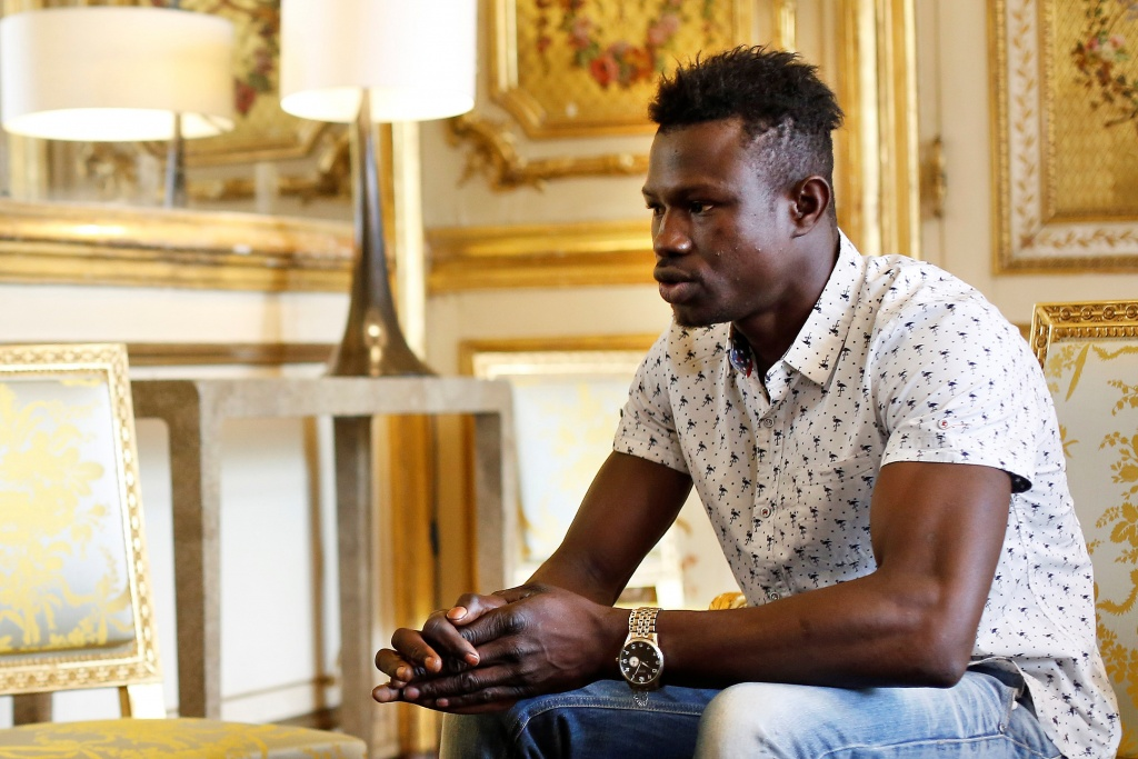 Mamoudou Gassama, 22, from Mali, is pictured during a meeting with French President Emmanuel Macron at the Elysee Palace in Paris
