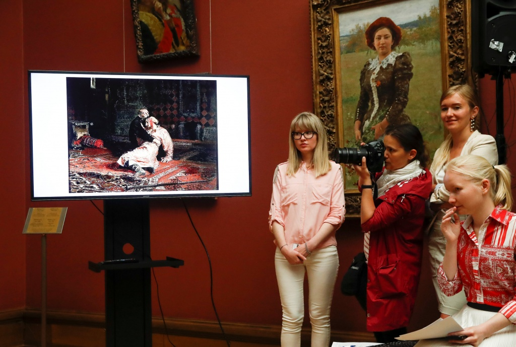 "Journalists attend a news conference dedicated to the damaged painting ""Ivan the Terrible and His Son Ivan on November 16, 1581"" at the State Tretyakov Gallery in Moscow"