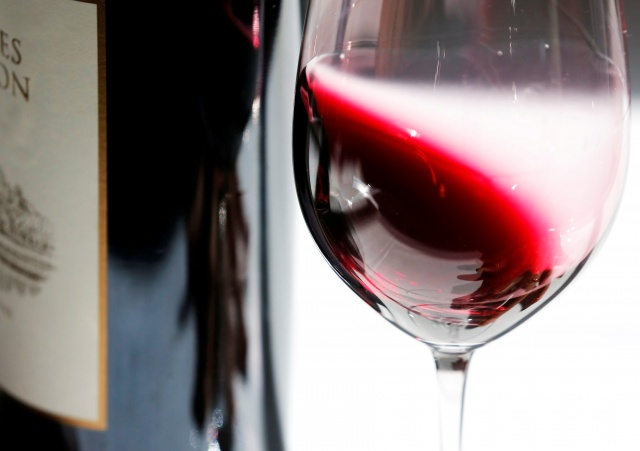 Glass of red wine is pictured at the Chateau Malartic-Lagraviere during the start of the Primeurs, a week of wine tasting at the chateaux in the Bordeaux region