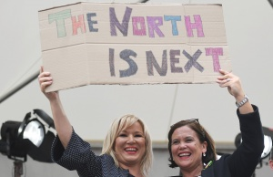 Sinn Fein leader Mary Lou McDonald and Michelle O'Neill leader of Sinn Fein in Northern Ireland hold up a placard as they celebrate the result of yesterday's referendum on liberalizing abortion law, in Dublin