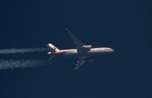 Malaysian Airlines Boeing 777 with the registration number 9M-MRO flies over Poland
