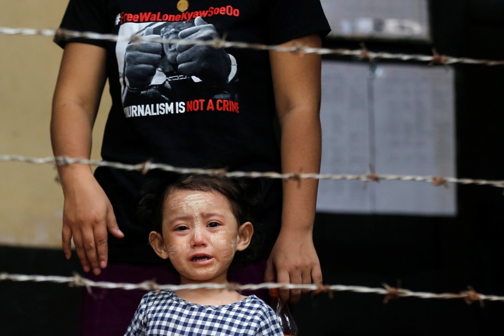 Detained Reuters journalist Kyaw Soe Oo's daughter Moe Thin Wai Zin stands outside the court during a hearing in Yangon