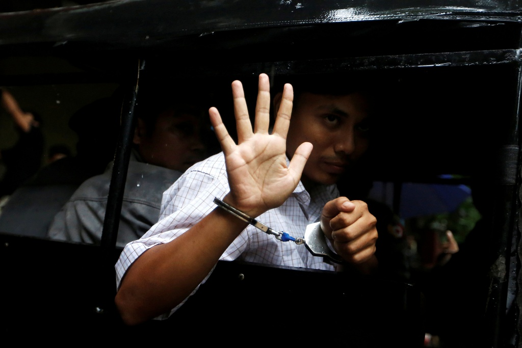 Detained Reuters journalist Kyaw Soe Oo leaves in a police vehicle after a court hearing in Yangon