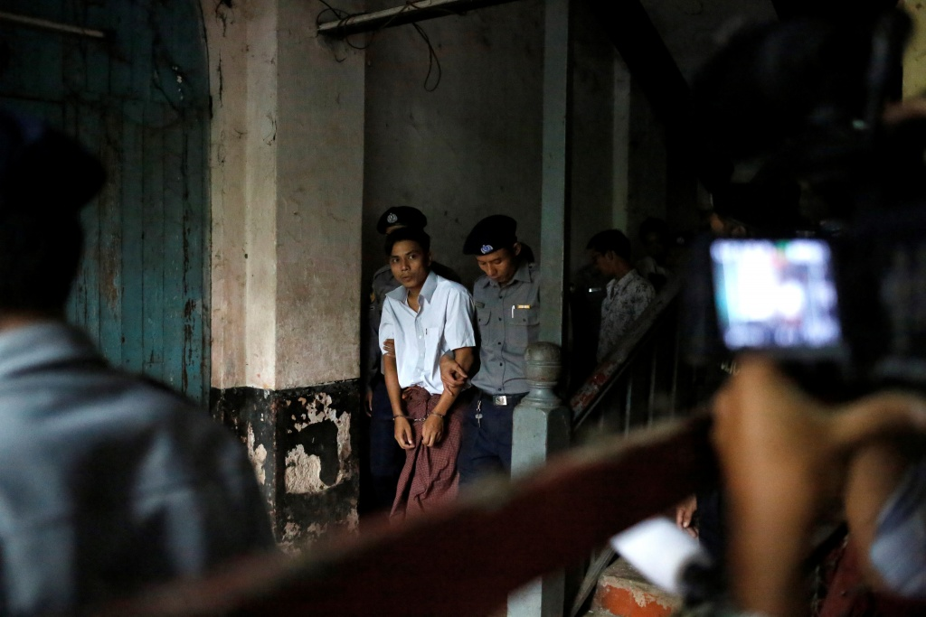 Detained Reuters journalist Kyaw Soe Oo leaves after a court hearing in Yangon