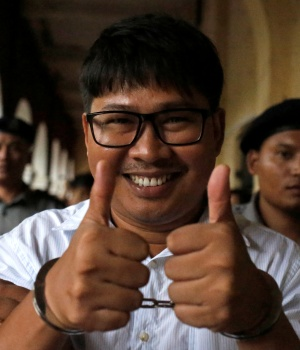 Detained Reuters journalist Wa Lone leaves after a court hearing in Yangon