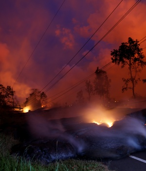 Volcanic gases rise from the Kilauea lava flow that crossed Pohoiki Road near Highway 132, near Pahoa, Hawaii