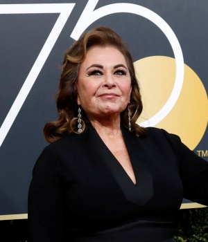 Actress Roseanne Barr waves on her arrival to the 75th Golden Globe Awards in Beverly Hills