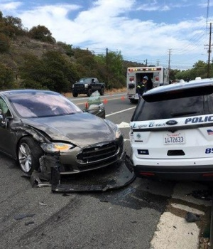 A Tesla sedan is shown after it struck a parked Laguna Beach Police Department vehicle in Laguna Beach, California, U.S. in this handout photo