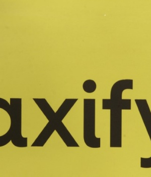 Taxify logo is pictured on a taxi cab in Riga