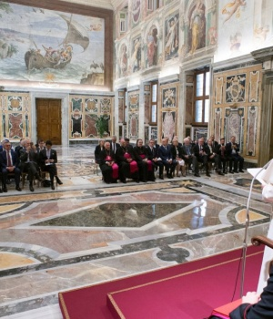 Pope Francis poses with oil and energy leaders during a private meeting at the Vatican