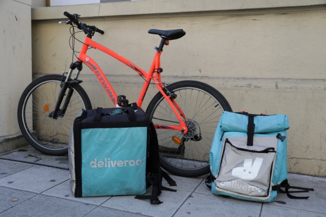 Deliveroo food delivery bags are seen in Nice