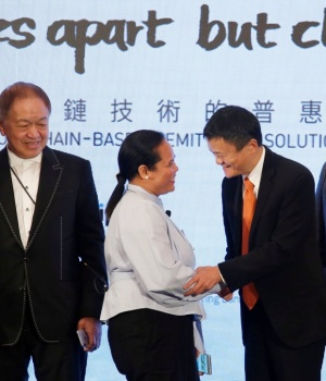 Alibaba Group co-founder and executive chairman Jack Ma greets a Filipino guest during a news conference in Hong Kong