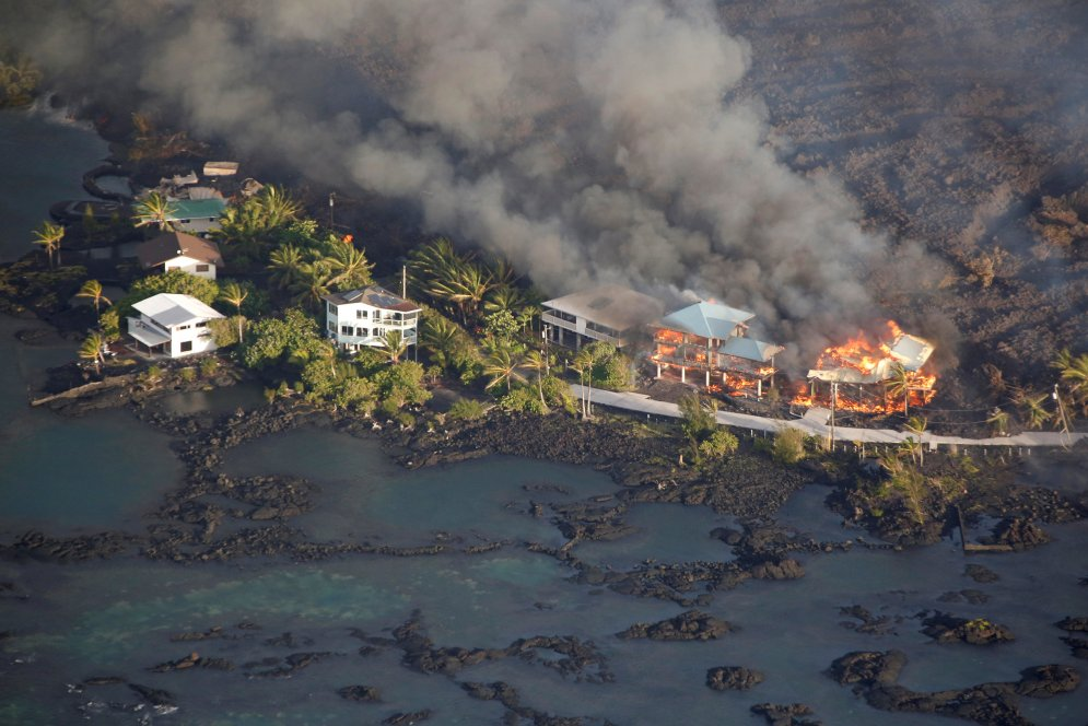 Lava destroys homes in the Kapoho area, east of Pahoa, during ongoing eruptions of the Kilauea Volcano in Hawaii