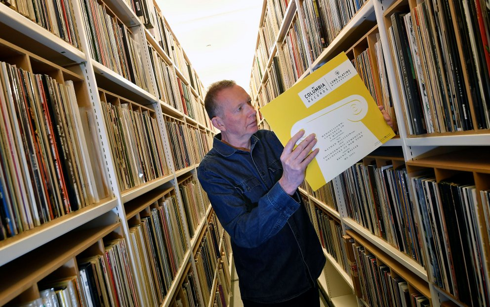 Andy Linehan, Curator of Popular Music Recordings at the British Library, checks a limited edition pressing of Mendelssohn's Violin Concerto in E Minor 1948 recording - the very first 33rpm vinyl LP to be issued