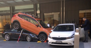 Hotel staff and guests can be seen near a car accident outside the main entrance of a hotel located in the central business district of Sydney