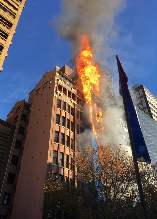 Flames can be seen coming from a building on fire in Sydney's central business district