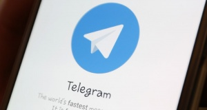 The Telegram logo is seen on a screen of a smartphone in this picture illustration