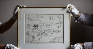 Sotheby's staff hold the original map of Winnie the Pooh's Hundred Acre Wood by E.H. Shepard at Sotheby's auction rooms in London