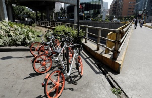 Mobikes are parked next to an avenue after Chinese bike sharing company MOBIKE launched its service in Mexico City