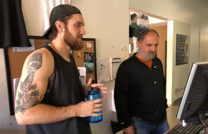 Employee Jason Etchingham and co-owner of FLEX, George Mardigian, look over reservations at his gym in Oakland