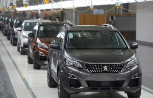 Vehicles are seen at a Dongfeng Peugeot Citroen factory before it starts up production in Chengdu