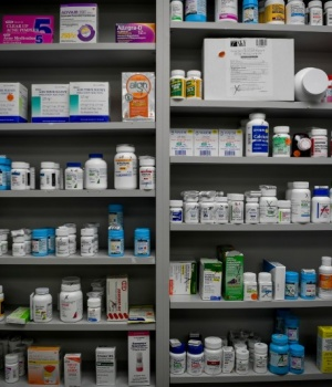 Bottles of medications line the shelves at a pharmacy in Portsmouth