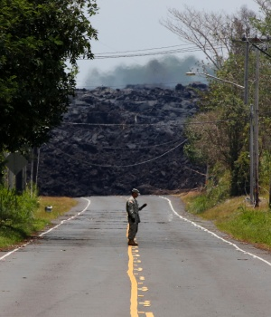 Sgt. Gavin Ching of the Hawaii National Guard monitors sulfur dioxide gas levels near a lava flow on Highway 132 in Pahoa