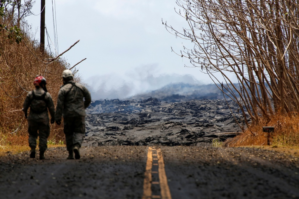 Soldiers from the Hawaii National Guard monitor sulfur dioxide gas levels near a lava flow in Leilani Estates during ongoing eruptions of the Kilauea Volcano in Hawaii