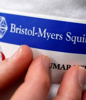 Logo of global biopharmaceutical company Bristol-Myers Squibb is pictured on the blouse of an employee in Le Passage