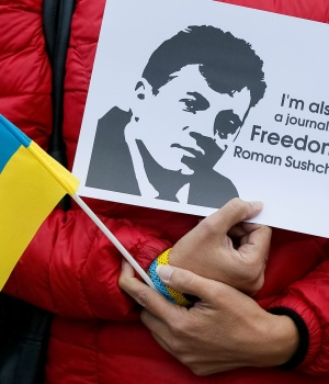 A participant protests against the detention of Ukrainian journalist Sushchenko during a rally near the Russian embassy in Kiev