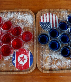 Special red and blue shots offered at Escobar bar to mark the summit meeting between U.S. President Donald Trump and North Korean leader Kim Jong Un, are displayed on a table in Singapore