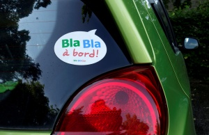 A sticker of French ride-sharing start-up BlaBlaCar is seen on a car at Le Coudray-Montceaux