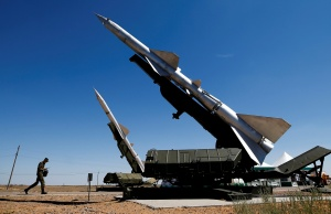 A serviceman walks past anti-aircraft defence mobile missile systems during the Keys to the Sky competition at the International Army Games 2017 at the Ashuluk shooting range outside Astrakhan