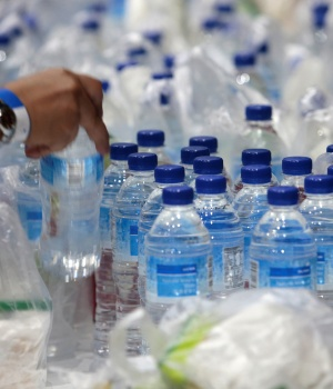 Plastic bags and bottles are given out during an event in Singapore